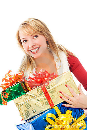 Surprised girl with Christmas presents
