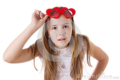 Surprised girl with funny glasses heart-shaped Stock Photo