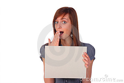 Surprised girl holding a blank card, isolated