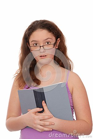 Surprised girl holds a  textbook.