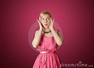 Surprised girl in pink