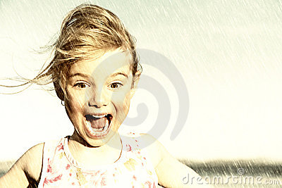 Surprised girl in rain
