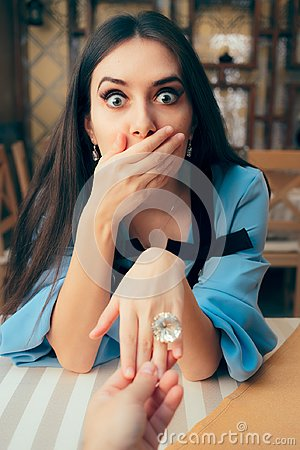 Free Surprised Girl Receiving Engagement Ring From Her Boyfriend Royalty Free Stock Images - 124455099