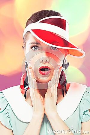 Surprised girl in red sun visor