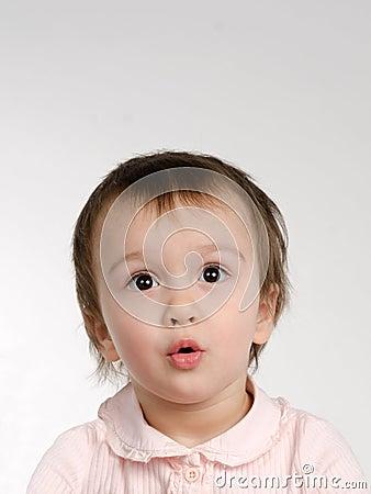 Surprised joyful baby girl