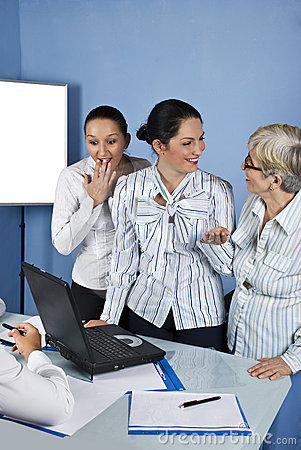 Surprised and laughing business woman in office