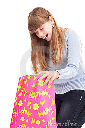 Surprised little girl with gift