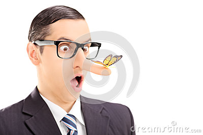 Surprised man with a butterfly on his nose