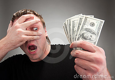 Surprised man with money