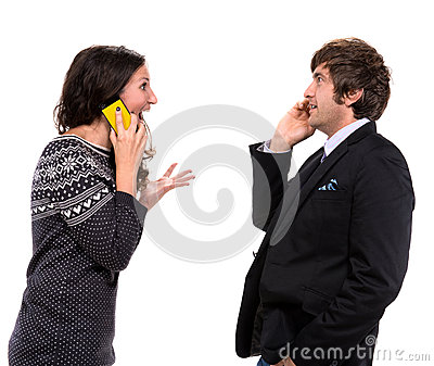 Surprised man and woman with cell phones