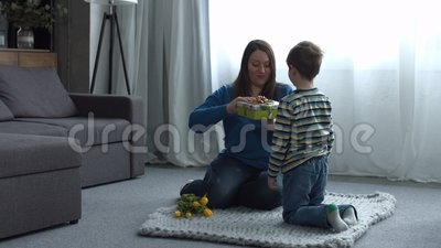 Surprised mother receiving present from her child stock video footage