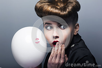 Surprised pin-up shopper girl with balloon