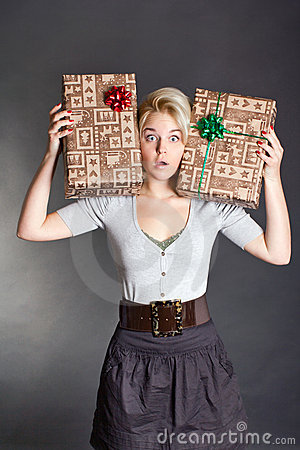 Surprised pretty woman holding two gift box