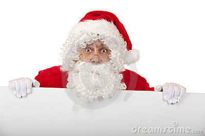 Surprised Santa Claus holds advertisment board