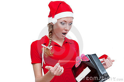 Surprised Santa helper looking into present box