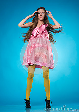 Surprised  teen girl in a pink dress