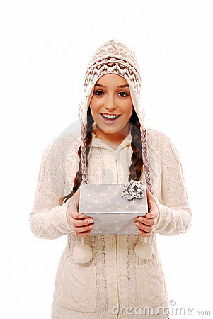 Surprised teenager holding christmas present