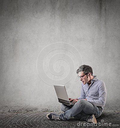 Surprised an using his laptop