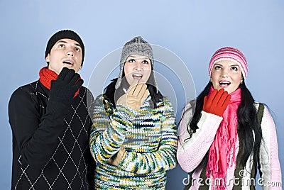 Surprised winter people looking up