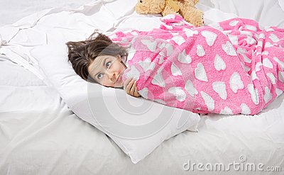 Surprised woman in bed