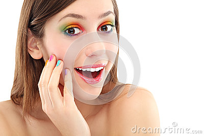 Surprised woman with colorful eyeshadow
