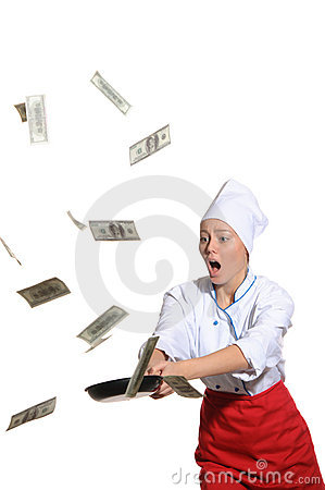 Surprised woman-cook frying pan catches money