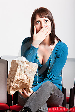 Surprised woman covering mouth with hand