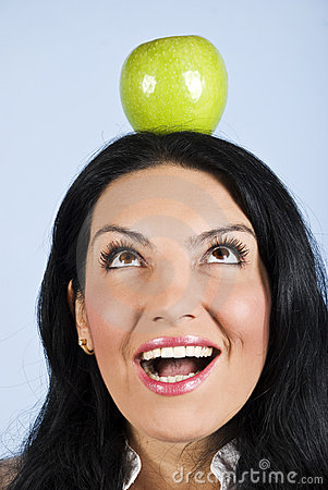Surprised woman hold an apple on head