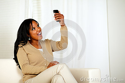 Surprised woman holding her cellphone up