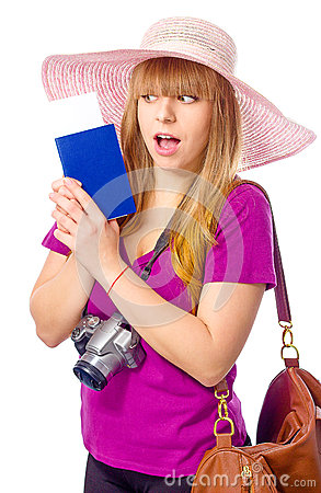 Surprised woman is holding a passport with ticket Stock Photo