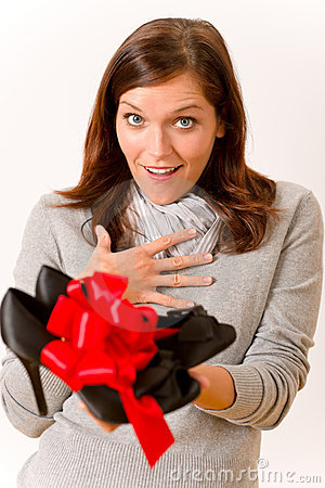 Surprised woman holding present shoes