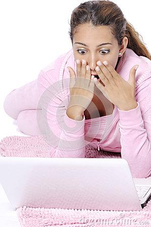 Surprised woman looking backward with laptop