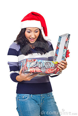 Surprised woman opening Christmas gift