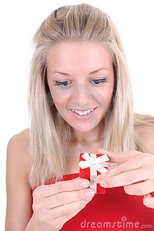 Surprised woman opening red present
