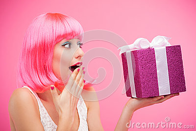 Surprised woman receiving gift