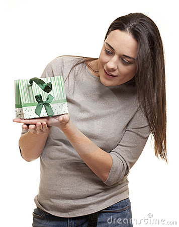 Surprised woman after receiving a present