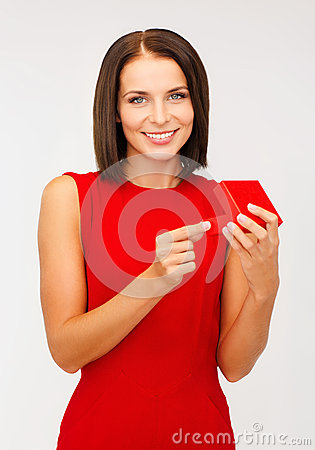 Surprised woman in red dress with gift box