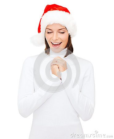 Surprised woman in santa helper hat