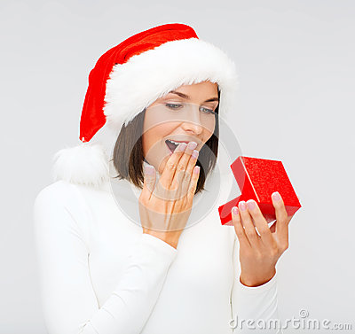 Surprised woman in santa helper hat with gift box