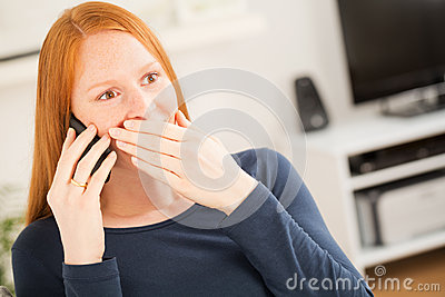 Surprised Woman Talking on a Phone at Home