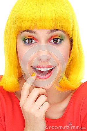 Surprised woman wearing yellow wig