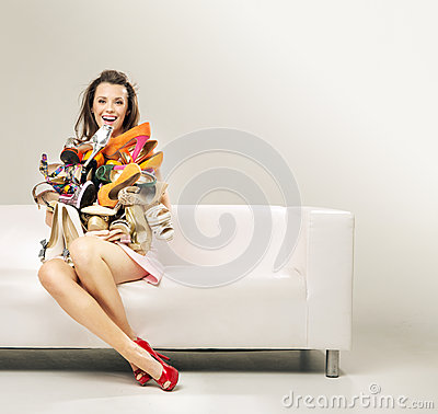 Free Surprised Woman With The Heap Of Shoes Stock Photos - 39995653