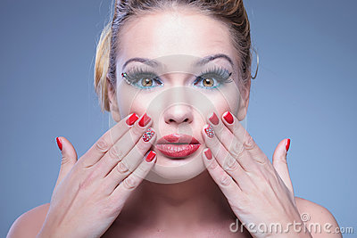 Surprised young beauty woman with fingers on her face