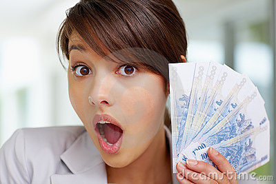 Surprised - Young woman with fan of currency notes