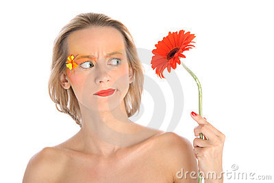 Surprised young woman with flower