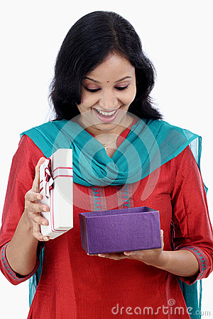 Surprised young woman with gift box Stock Photo