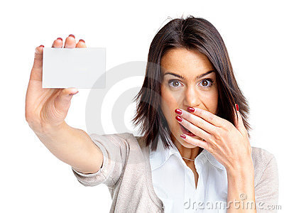Surprised young woman holding a small blank card