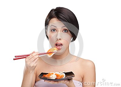 Surprised young woman holding sushi
