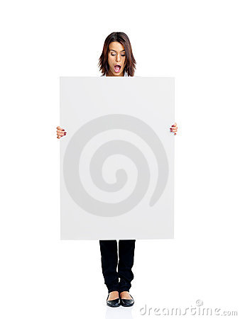Surprised young woman looking at empty white board