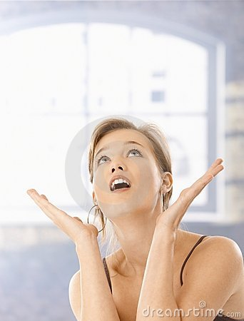Surprised young woman with open mouth
